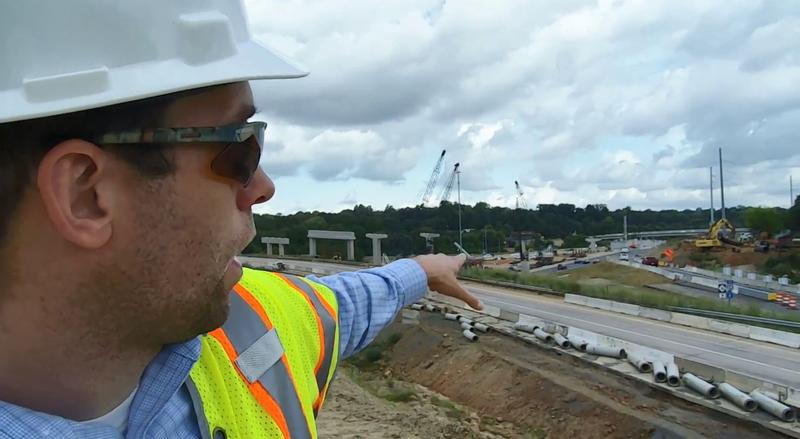 David Hannon of I-77 Mobility Partners points to ramp construction at the I-277 and I-77 interchange in Charlotte during a tour this week.