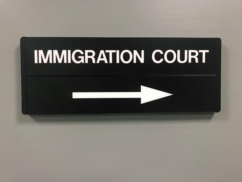 Directional sign in the lobby of the Charlotte immigration court.