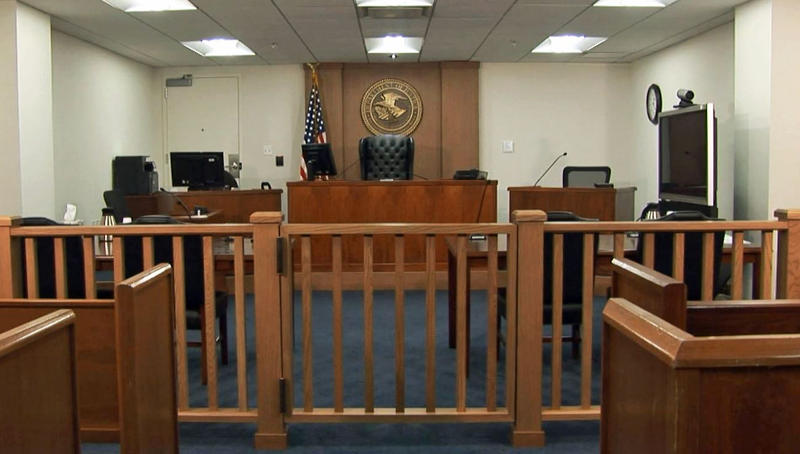 Inside of an Executive Office for Immigration Review courtroom.