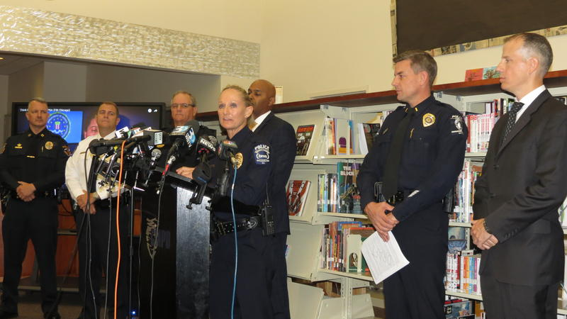 CMS Chief of Police Lisa Mangum, center, is flanked by an FBI special agent and other police chiefs to announce a new campaign to stop hoax threats.