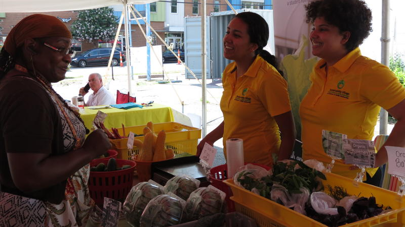 JCSU students sell fresh fruits and vegetables produced at campus greenhouses.