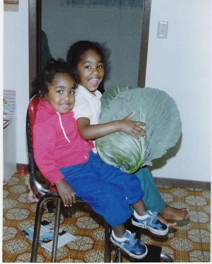 Gopo, left, and sister Laurel with cabbage from family's backyard garden in Anchorage.