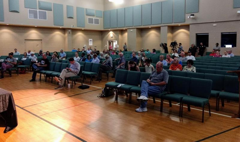 Organizers were ready for a larger crowd, but only a few dozen people came and only nine spoke at Huntersville United Methodist Church.