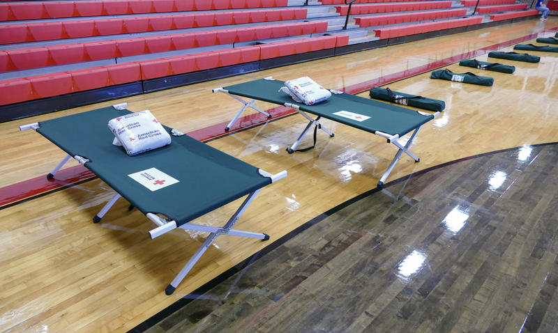 Cots lined up inside a Red Cross shelter at South Mecklenburg High School on Wednesday. The Red Cross has opened four shelters in Charlotte, with plans to open a fifth in the near future.
