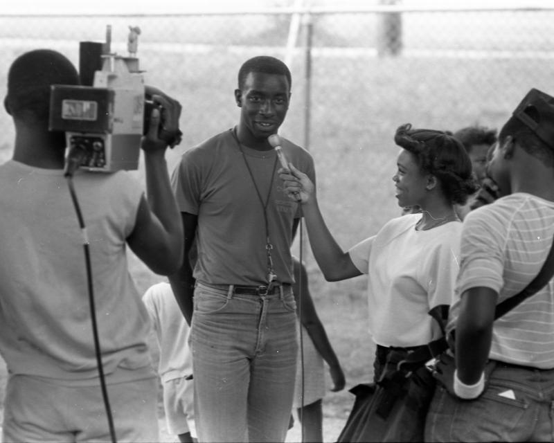 Earle Village teenagers got a chance to interview each other using equipment from (now defunct) TV-station WPCQ in 1984. Here, Makeeba Jackson interviews Ronald Smith at Earle Village park.