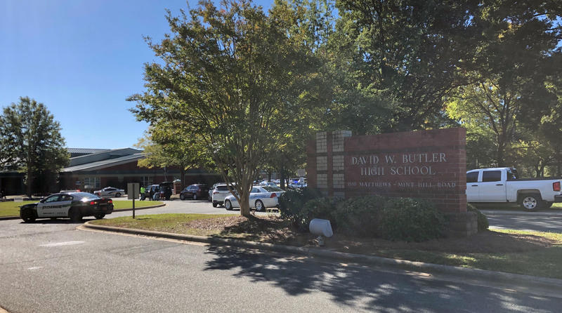 Police cars are stationed outside of Butler High School after a shooting Monday morning.