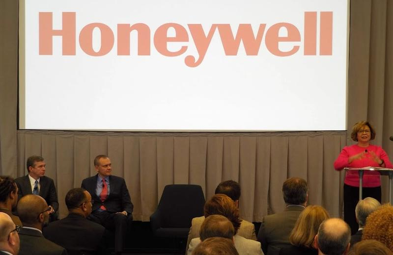 From left, Gov. Roy Cooper and Honeywell CEO Darius Adamczyk listen as Mayor Vi Lyles speaks during a ceremony in uptown Friday to announce Honeywell's headquarters is moving to Charlotte.