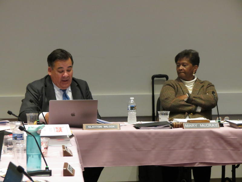 CMS Superindentent Clayton Wilcox presents report to school board as Chairman Mary McCray looks on