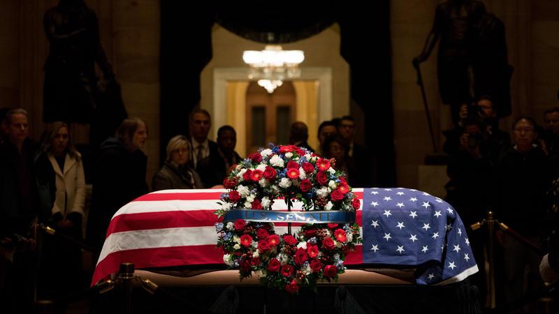 President George H. W. Bush's casket in the Capitol rotunda.