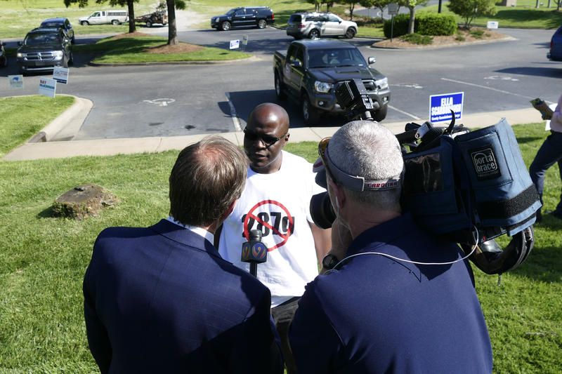 Then-candidate for sheriff Antoine Ensley speaking to reporters outside a polling location the day of the May 2018 primary.