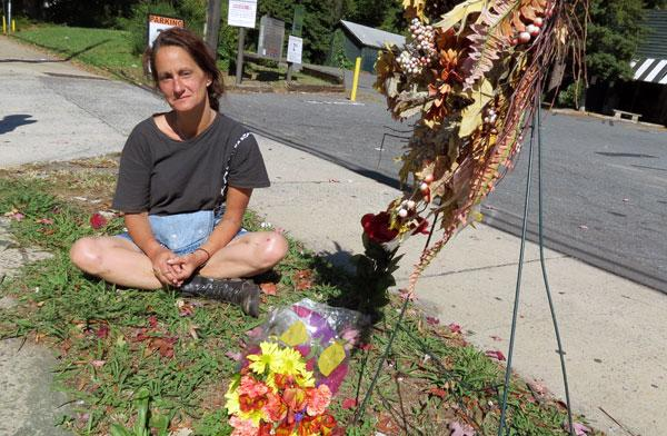 "Kathy Vestal remembers her friend ""Chilly Willy"" at a memorial on the curb where he was struck by a car Thursday night."