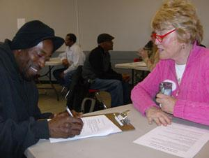 A volunteer collects information during a count of Charlotte's homeless population.