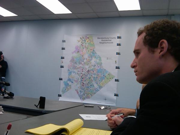 Witt Putney of Pearson's Appraisal Service explains a wall-sized map of Mecklenburg County showing hundreds of 2011 property valuations the firm is reviewing.