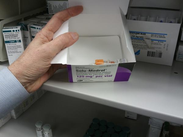Northern Hospital Pharmacy Director Darrell Estes checks his dwindling supply of a drug used in a variety of treatments.