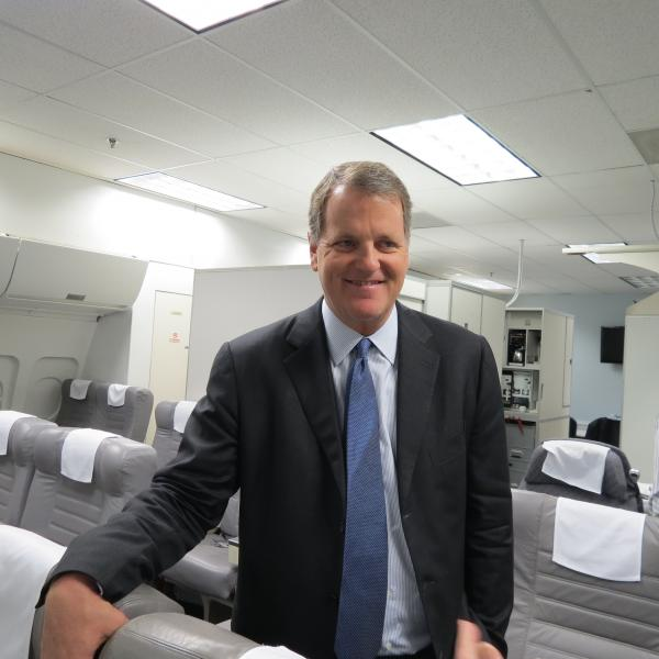 US Airways CEO Doug Parker visited the airline's training facility in Charlotte on Thursday, March 21, 2013 to tout a proposed merger with American Airlines.