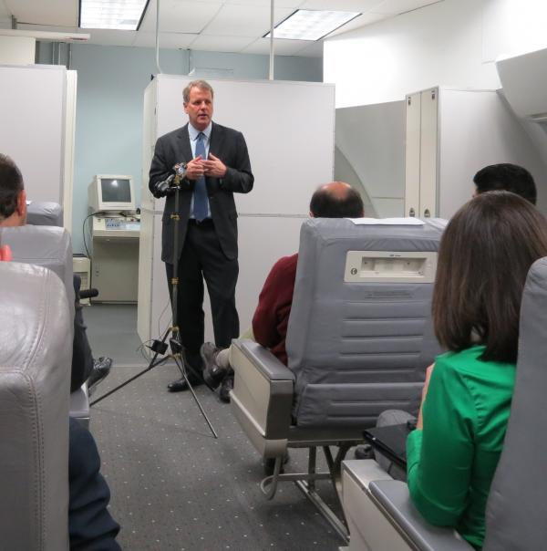 US Airways CEO Doug Parker speaking to media at the airline's training center in Charlotte on Thursday morning.