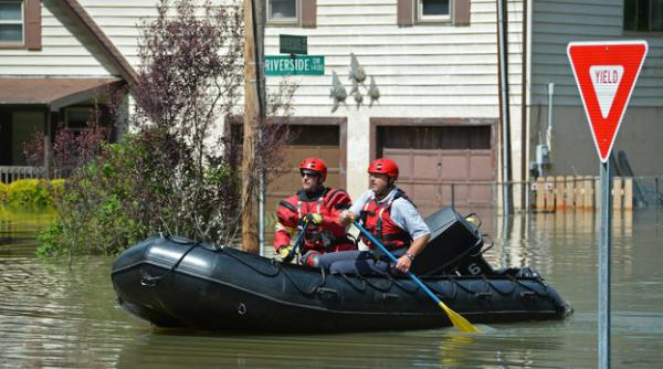 Charlotte Firefighters work to warn folks of the flooding danger along Riverside Drive which is closed due to flooding along the Catawba River in western Mecklenburg County. Firefighters were going door-to-door warning people about flooding.