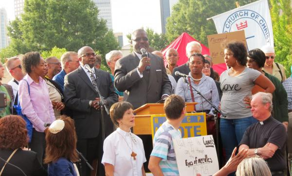 Reverend Dwayne Walker of Little A.M.E. Zion Church was the keynote speaker at Charlotte's Moral Monday in Marshall Park on August 19.