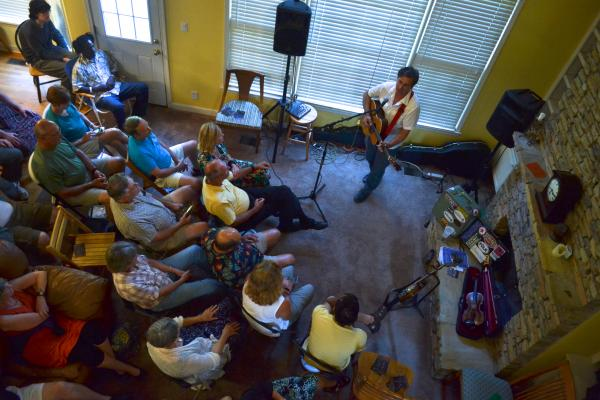 "The crowd listens closely during a concert at Judy Mace's home. ""I just wanted the chance to hear concerts ina place where people were really listening and respectful of the musicians,"" says Mace."