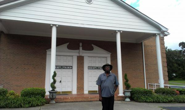 Gary Dawkins is president of the Hidden Valley Neighborhood Association. Here, he stands in front of the Greenville Memorial A.M.E. Zion Church.