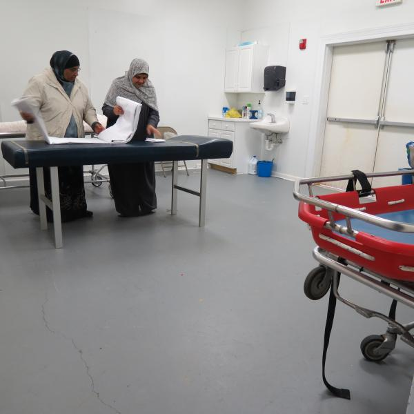 The washing room at the Islamic Society of Greater Charlotte is located in the back corner of a multipurpose hall next to the mosque. The hall includes an indoor basketball court where tournaments, funeral prayers, weddings and carnivals are held back to back. Volunteers organize the white sheets they will need to wrap around the body after the wash.