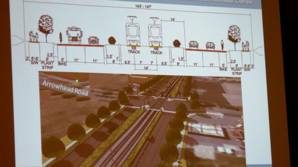 There will be two lanes for motor vehicles to the left of the train tracks and two lanes to the right.