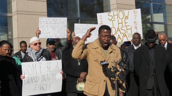 Minister Dwayne Collins of Greenville A.M.E. Zion church was one of six church leaders who prayed during a protest for the grand jury to issue an indictment outside the government center.