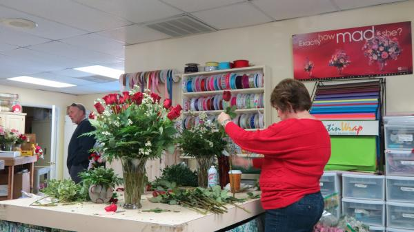 Beth Downs is one of many friends and family members who came in to help Gallery of Flowers owner Linda Koch with Valentine's Day orders.