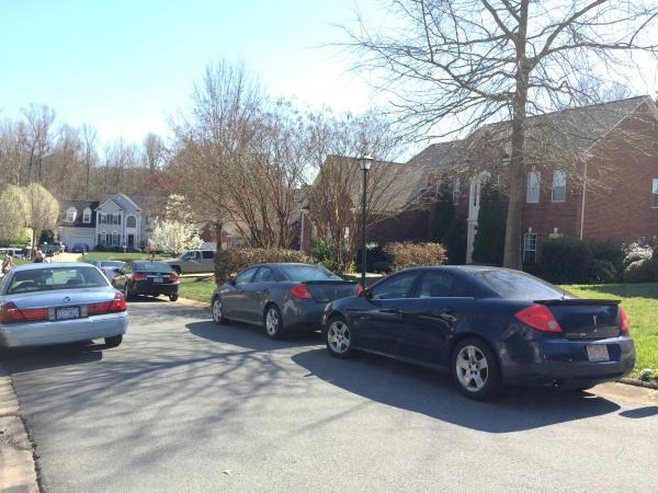 Cars, some with the FBI, parked outside of Mayor Cannon's house in Ballantyne on Wednesday afternoon.