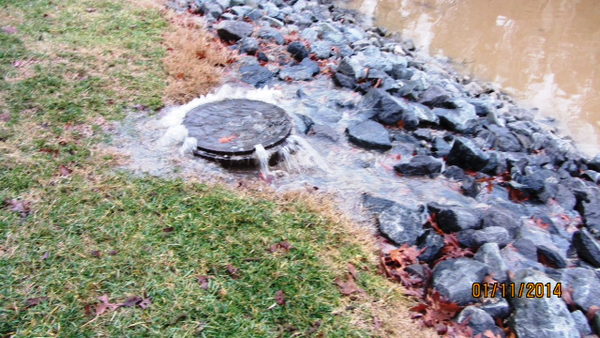 A photo of a sewer system overflow on January 11, 2014 from one of Tega Cay Water Service's manholes into Lake Wylie. On March 7, 48,500 gallons of sewage burst from two manholes and a wasterwater treatment plant into Lake Wylie.