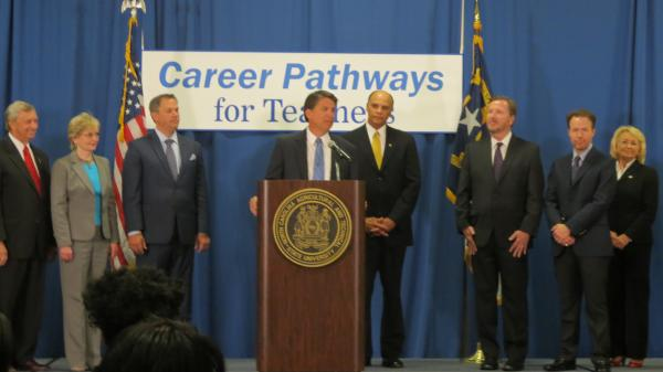 Governor McCrory announces his teacher pay plan flanked by two school district superintendents, two state lawmakers, the Lieutenant Governor and the state school superintendent.