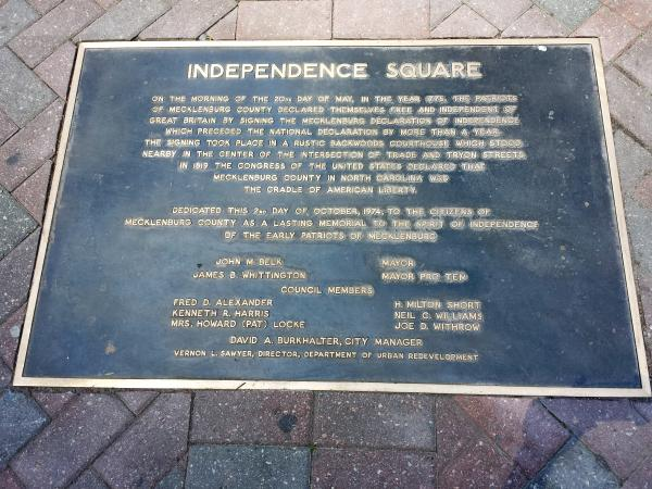 A plaque commemorating the Mecklenburg Declaration of Independence on the corner of Trade and Tryon Street in uptown Charlotte. Many Charlotte streets, parks and public areas like Independence Square, are named in honor of the Meck Dec.