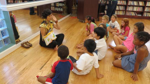 XiaoSong He reads to students enrolled in the Chinese language  summer camp at the Asian Library.