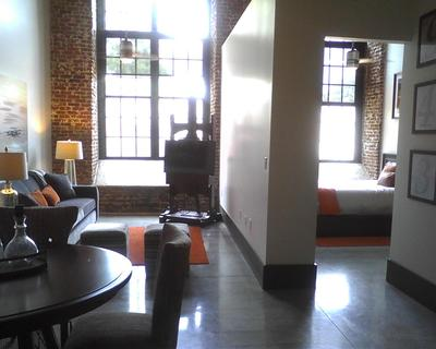 The Renovated Loray Mill Features Loft Apartments With Floor To Ceiling Original Window Frames And 100 Year Old Wooden Beams Intact