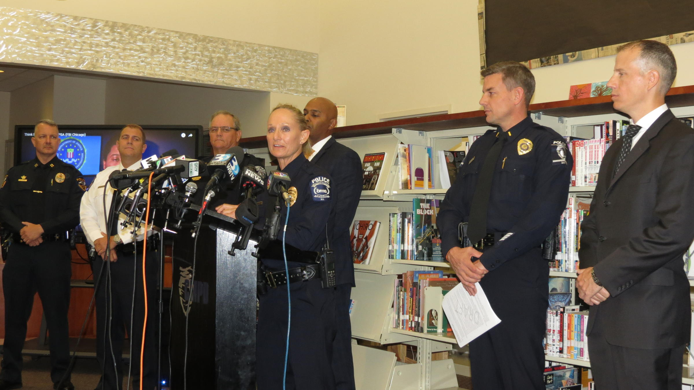 cms chief of police lisa mangum center is flanked by an fbi special agent and other police chiefs to announce a new campaign to stop hoax threats