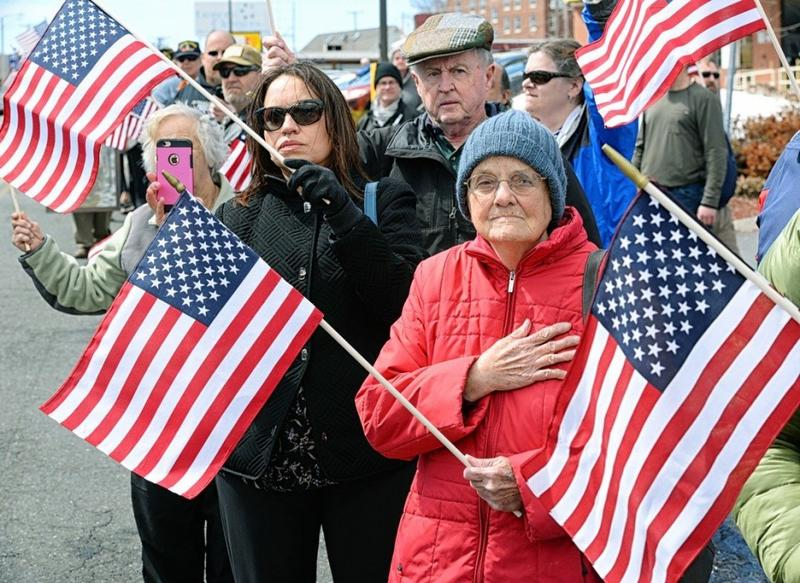 June Powell, an Air Force Veteran from Holyoke stands on South Street on March 29, 3017, to welcome the remains of U.S. Army Cpl. Jules Hauterman Jr., who was killed in North Korea in 1950.