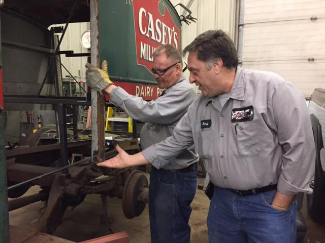 Gary Cloutier (right), at his auto body shop in Westfield, Mass.