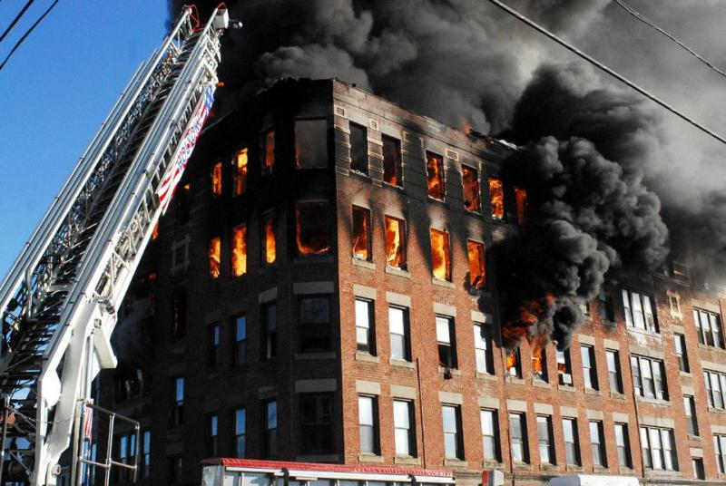 Fire quickly consumed the building at 106 North East Street in Holyoke on Jan. 1, 2017.