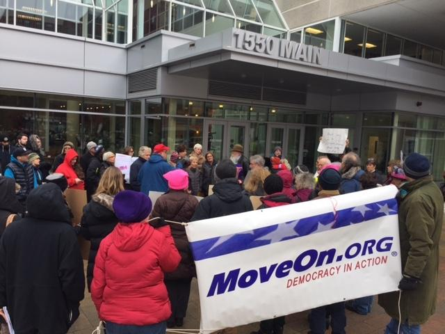 Activists rally outside the Springfield, Mass., offices of Senators Elizabeth Warren and Ed Markey earlier this week to urge them to stand up to President Trump's nominees.