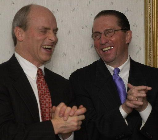 House Speaker Thomas M. Finneran, left, and state Rep. Thomas M. Petrolati, D-Ludlow, share a laugh during a political fundraiser in 2004.