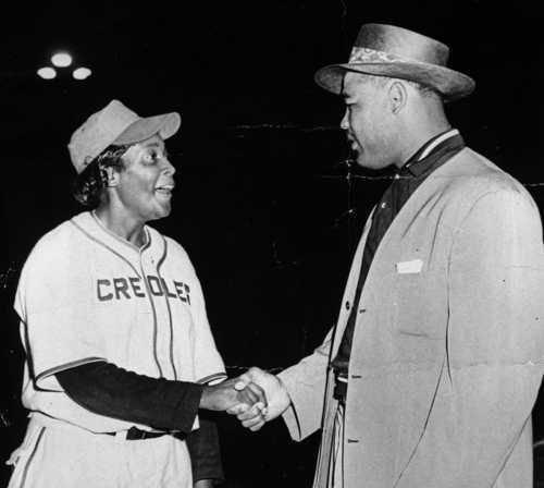 Toni Stone meeting her idol, boxer Joe Louis, c.1949.