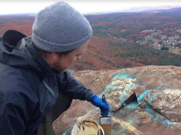 In November 2016, Damien Johnson was one of several people who painted a solvent on rocks atop Mount Tom to get rid of racist, anti-Semitic and homophobic messages.