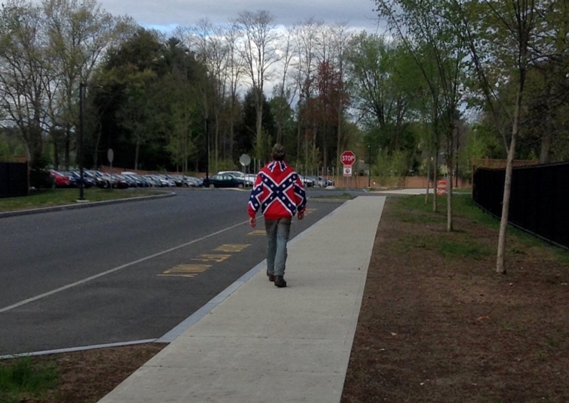 A person wearing a Confederate flag jacket, outside Easthampton High School on May 3, 2017.