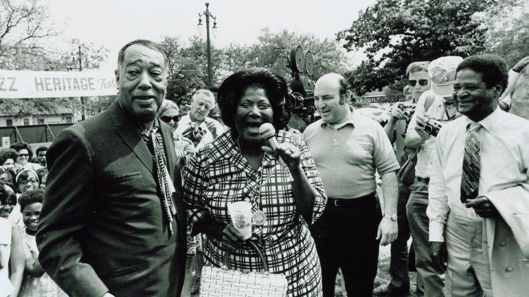 Duke Ellington, Mahalia Jackson, and George Wein (in polo jersey), 1970, New Orleans