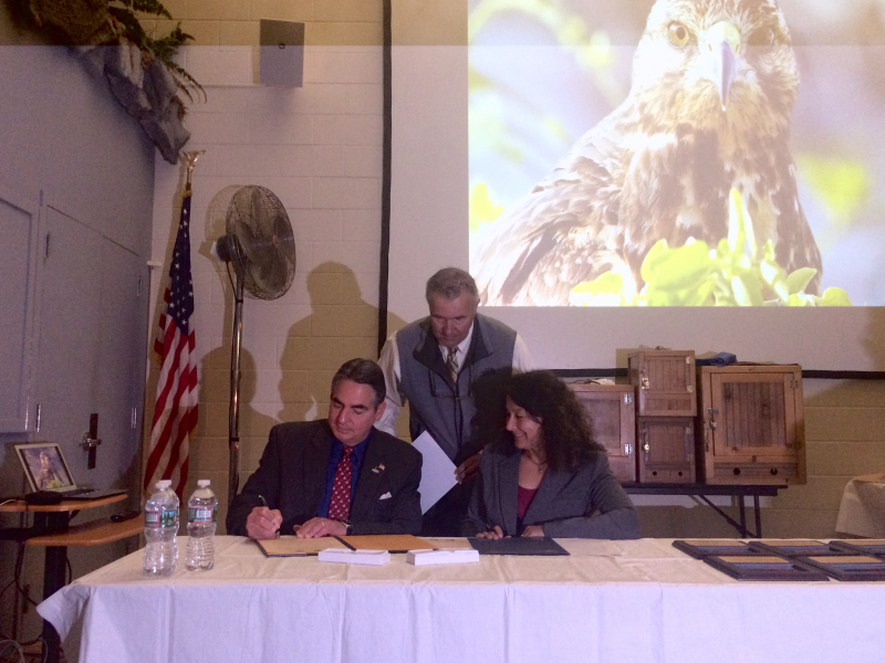 Springfield Mayor Domenic Sarno, left, signs the Urban Conservation Treaty for Migratory Birds with Roxanne Bogart, of the U.S. Fish and Wildlife Service, right, in Springfield on May 5, 2017.