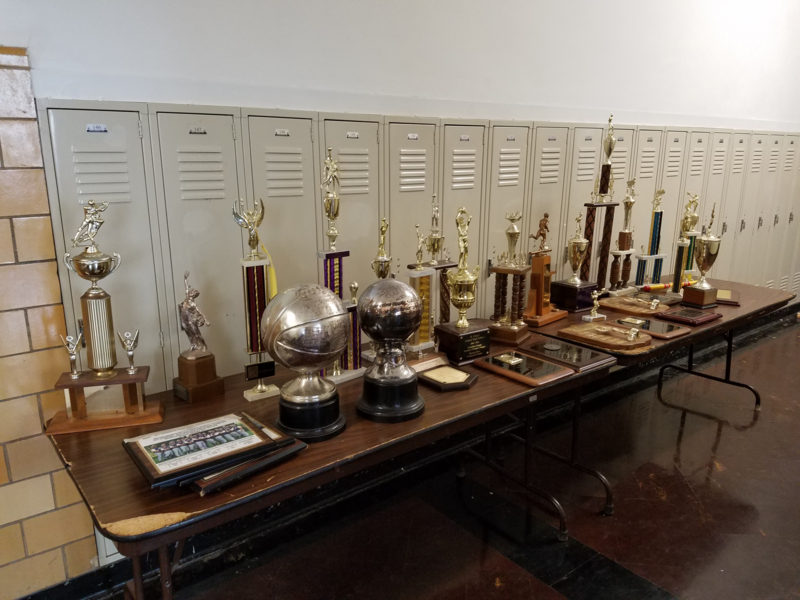 Athletic trophies awarded to various St. Joseph Crusader teams and athletes through the years.