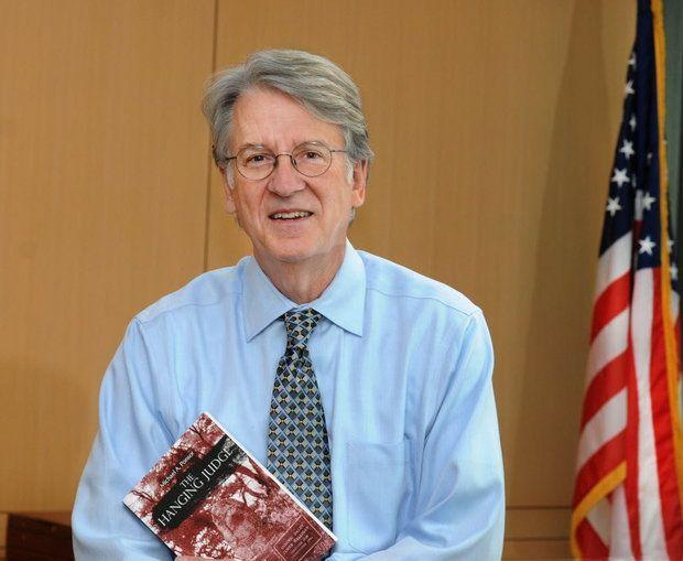 "Judge Michael Ponsor, holding his first novel, ""The Hanging Judge,"" which was published in 2013."