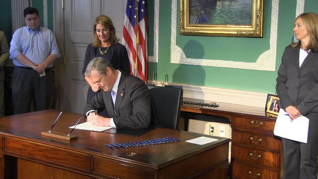 Gov. Baker signs fiscal 2016 budget on July 17, 2015.