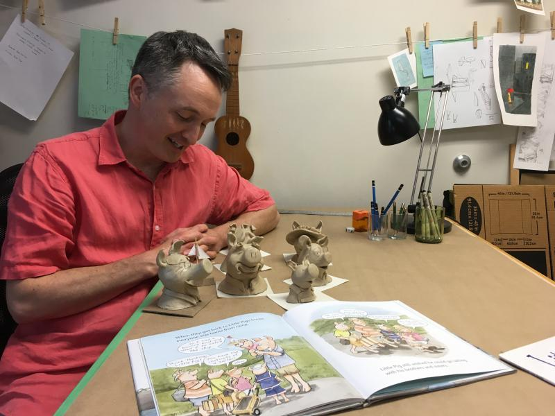 "Author David Hyde Costello with the clay models he referenced while illustrating his book ""Little Pig Saves The Ship."""