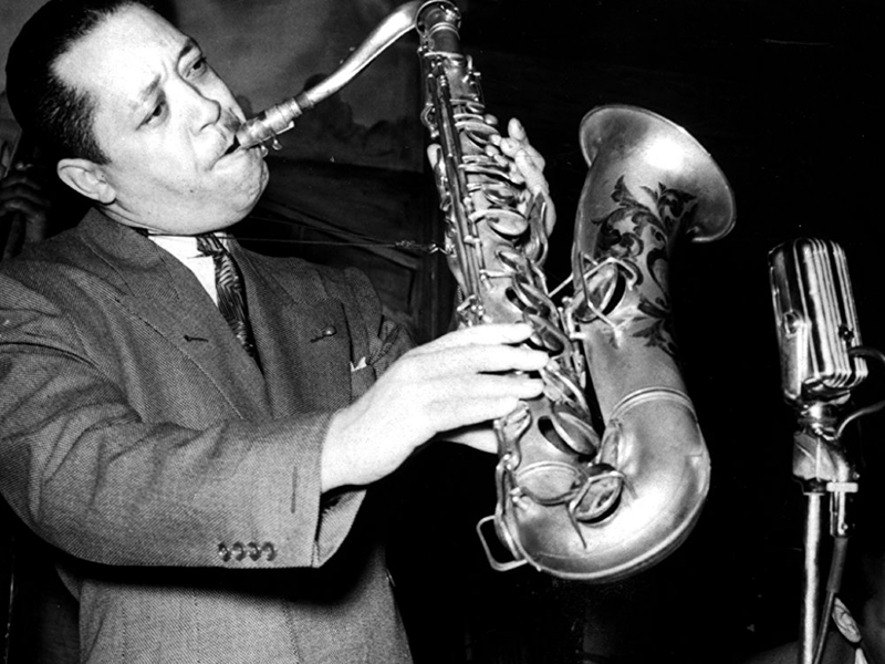 Lester Young playing tenor saxophone with the horn held at a 45-degree angle